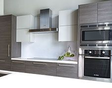 Merrick Manor condominum kitchen photos, displaying appliances by Bosch and Italian style cabinets