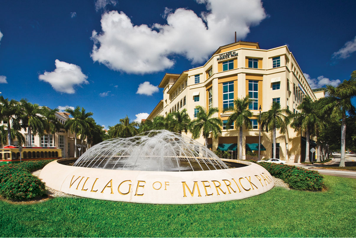 Village of Merrick Park Fountain. Tropical setting and bright blue sky.