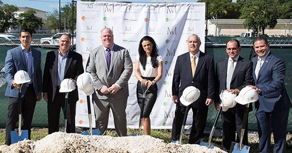 Merrick Manor ceremonial groundbreaking with shovels and construction hard hats.